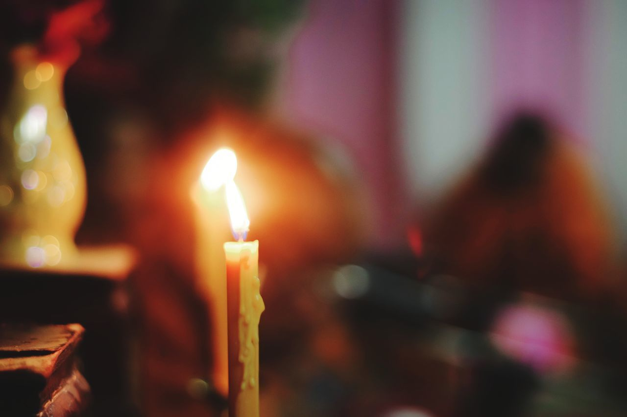 burning, flame, fire, candle, illuminated, fire - natural phenomenon, focus on foreground, heat - temperature, close-up, glowing, incidental people, religion, belief, spirituality, selective focus, place of worship, indoors, celebration, nature, melting