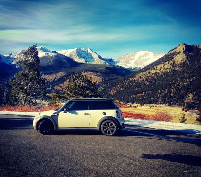 Mini on the mountain Land Vehicle Mode Of Transport Car Transportation Mountain Road Snow Winter Mountain Range Snowcapped Mountain Shadow Travel Street Cold Temperature Landscape Roadside Blue Sky Day Country Road Mini MiniCooper Minicooperworld Minicooperswag MinicooperS