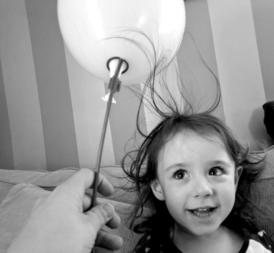 Playing with static. Looking At Camera Indoors  One Person Childhood Portrait Domestic Life People Close-up Day Child Home Interior Funtimes Daughter XL Pixel Xl Monochrome Fun Blackandwhite Real People Static Balloons Hair Zap BYOPaper!