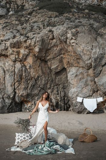Full Length One Person Rock - Object Rock Solid Women Adult Rock Formation Leisure Activity Real People Lifestyles Young Adult Nature Day Land Females Beauty In Nature Young Women Outdoors Dress