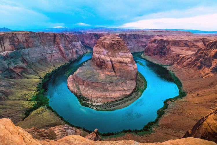 Horseshoe Bend Beauty In Nature Cliff Cloud Day Eroded Geology Idyllic Landscape Mountain Nature Non-urban Scene Physical Geography Remote Rock Rocky Mountains Scenics Sky Tourism Tranquil Scene Tranquility Travel Destinations Water Horseshoe Bend