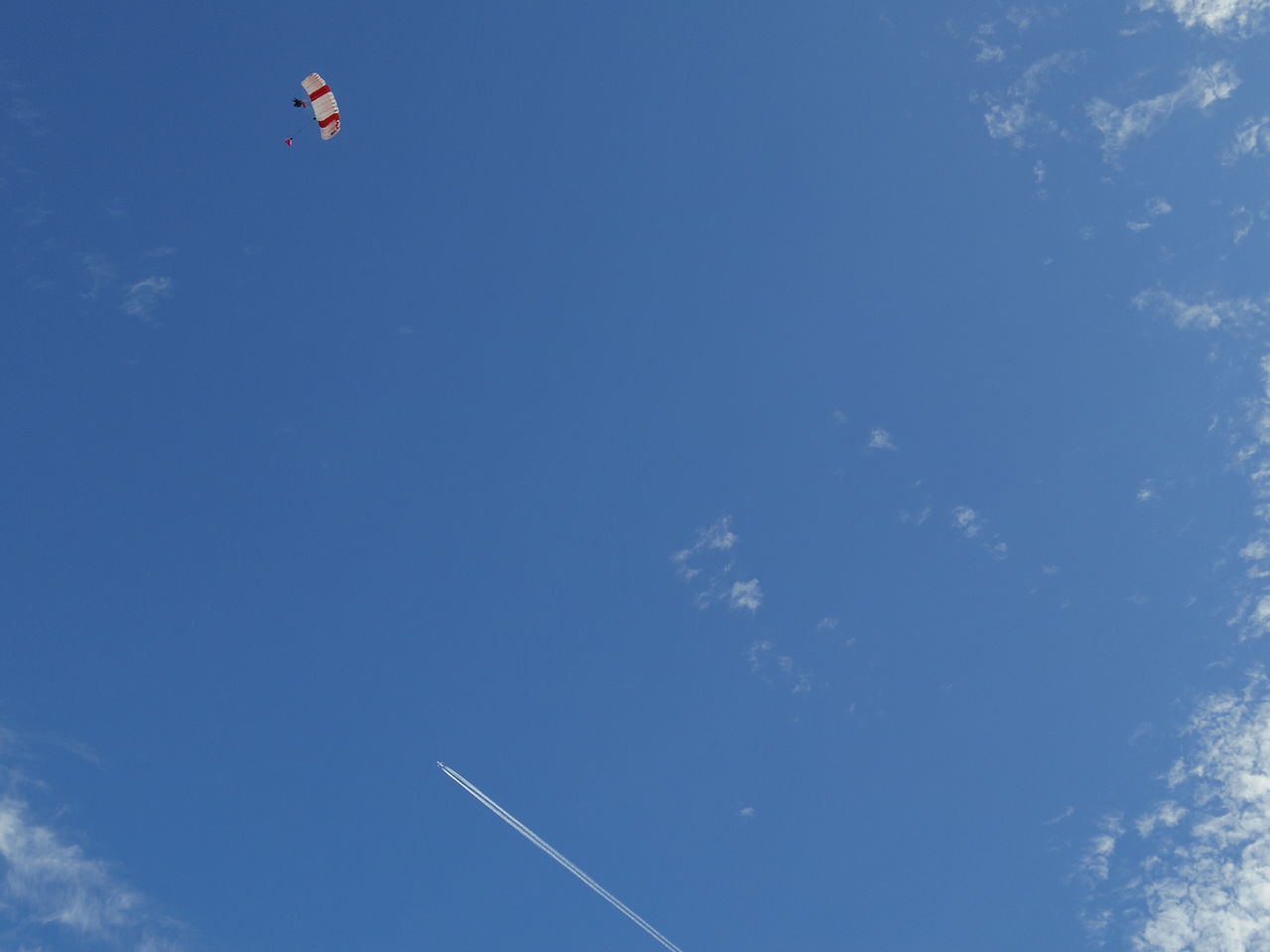 low angle view, blue, sky, day, nature, vapor trail, flying, outdoors, scenics, beauty in nature, contrail, no people