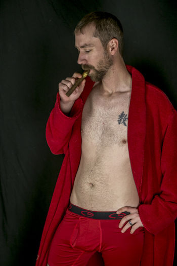 Adult Adults Only Black Background Boudoir Photography Cigar Luxury Men Mid Adult One Man Only One Person Only Men People Standing Studio Shot Waist Up