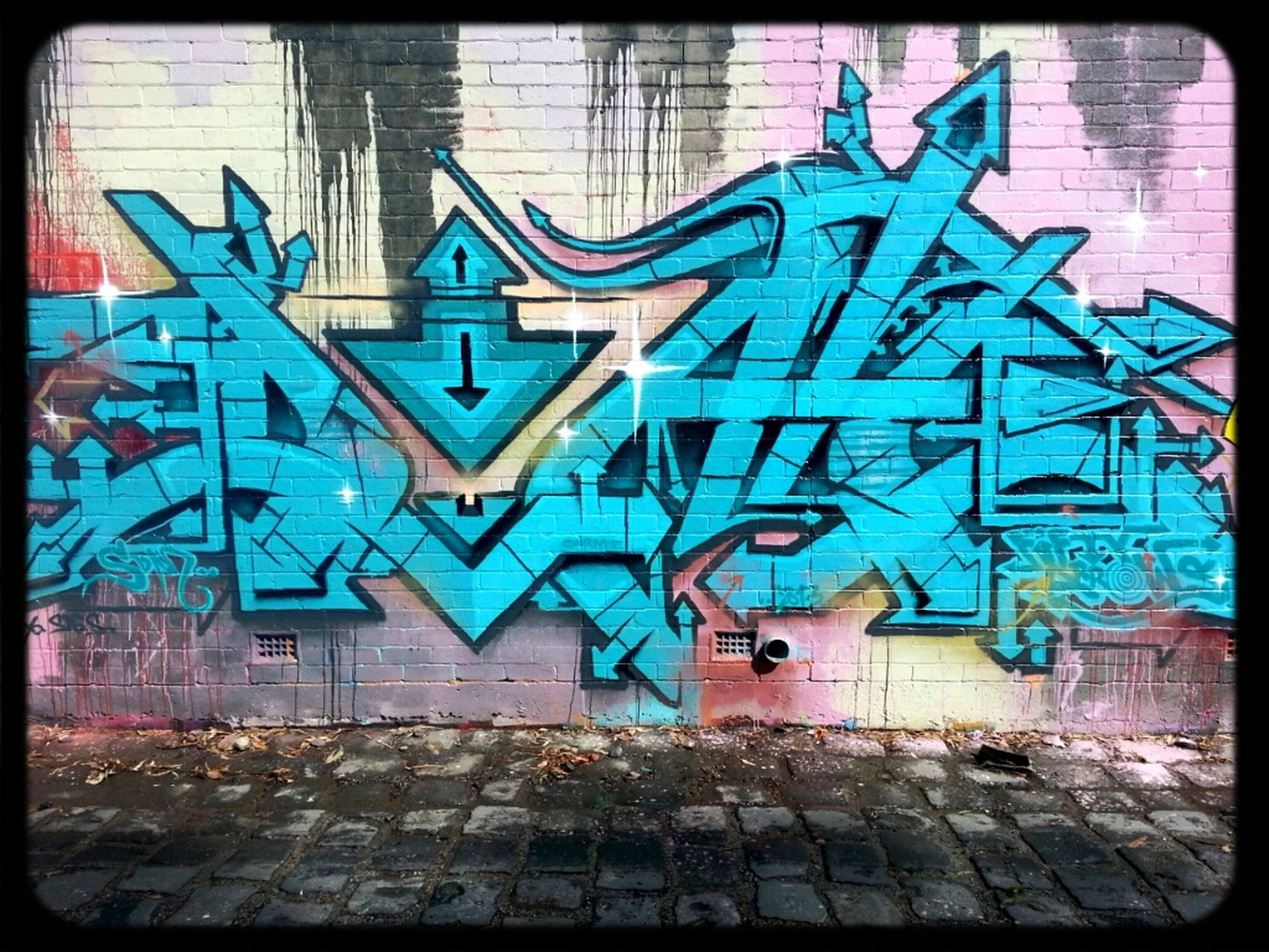 transfer print, graffiti, architecture, built structure, building exterior, auto post production filter, wall - building feature, art, creativity, art and craft, text, wall, multi colored, blue, street art, western script, brick wall, communication, window, no people