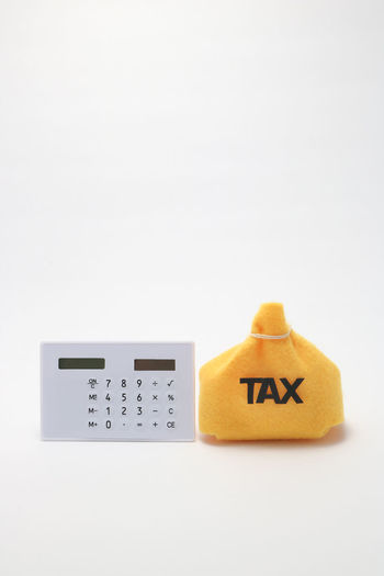 Budjet Hotel Copy Space Economy Household Loan  Revenue Accounting Asset Avoidance Balance Calculator Finance Income Income Tax Income Tax Return Indoors  Money No People Number Return Still Life Studio Shot Tax Tax Haven White Background