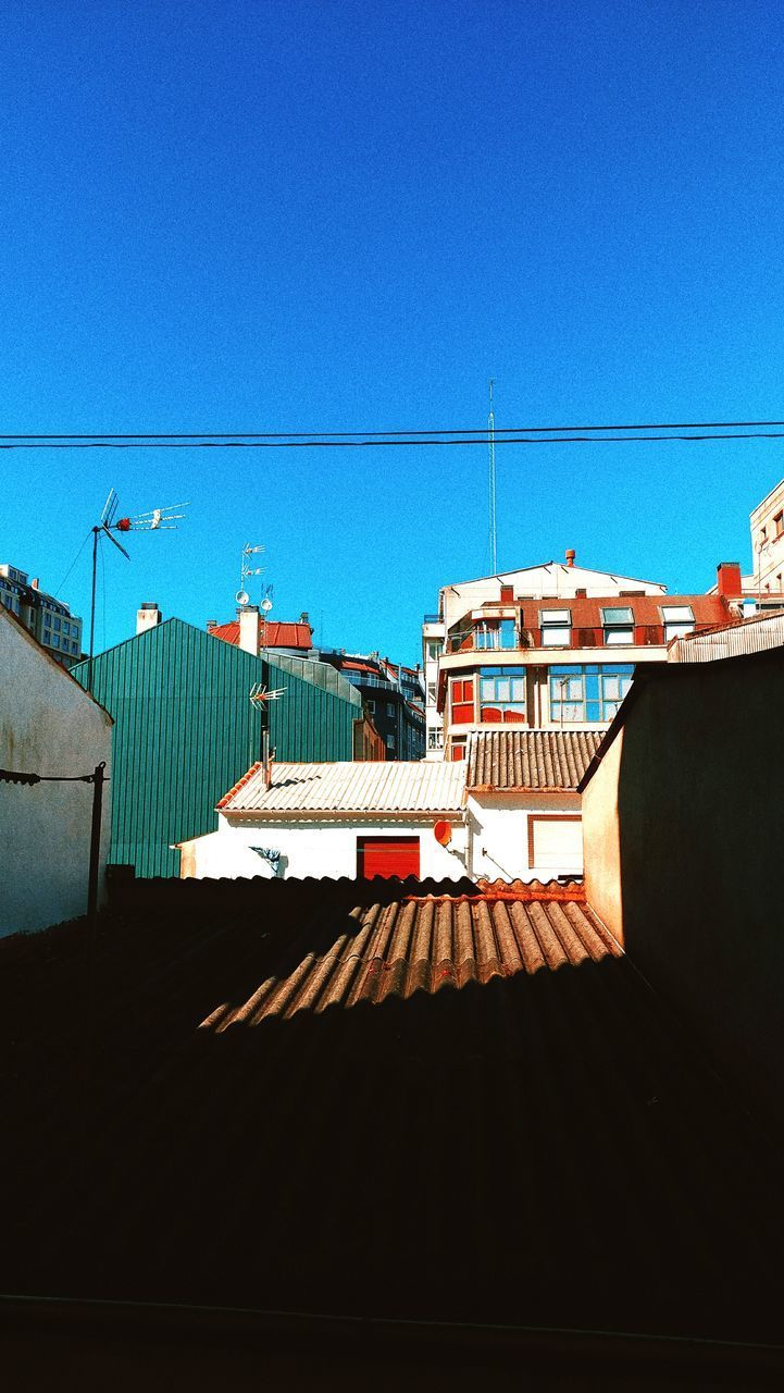 HOUSES AGAINST BLUE SKY IN TOWN