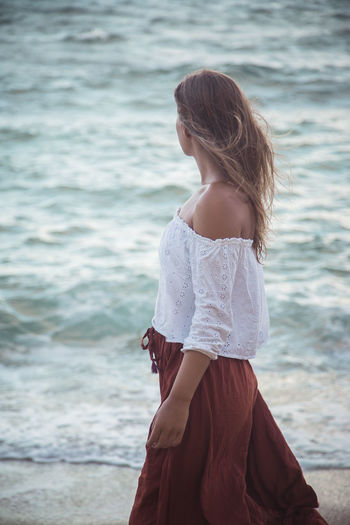 Young woman standing at beach