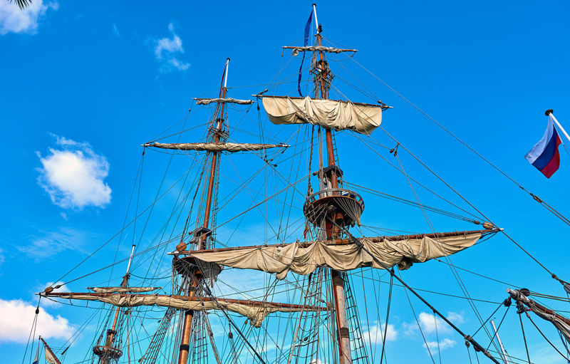 Mast of frigate against blue sky