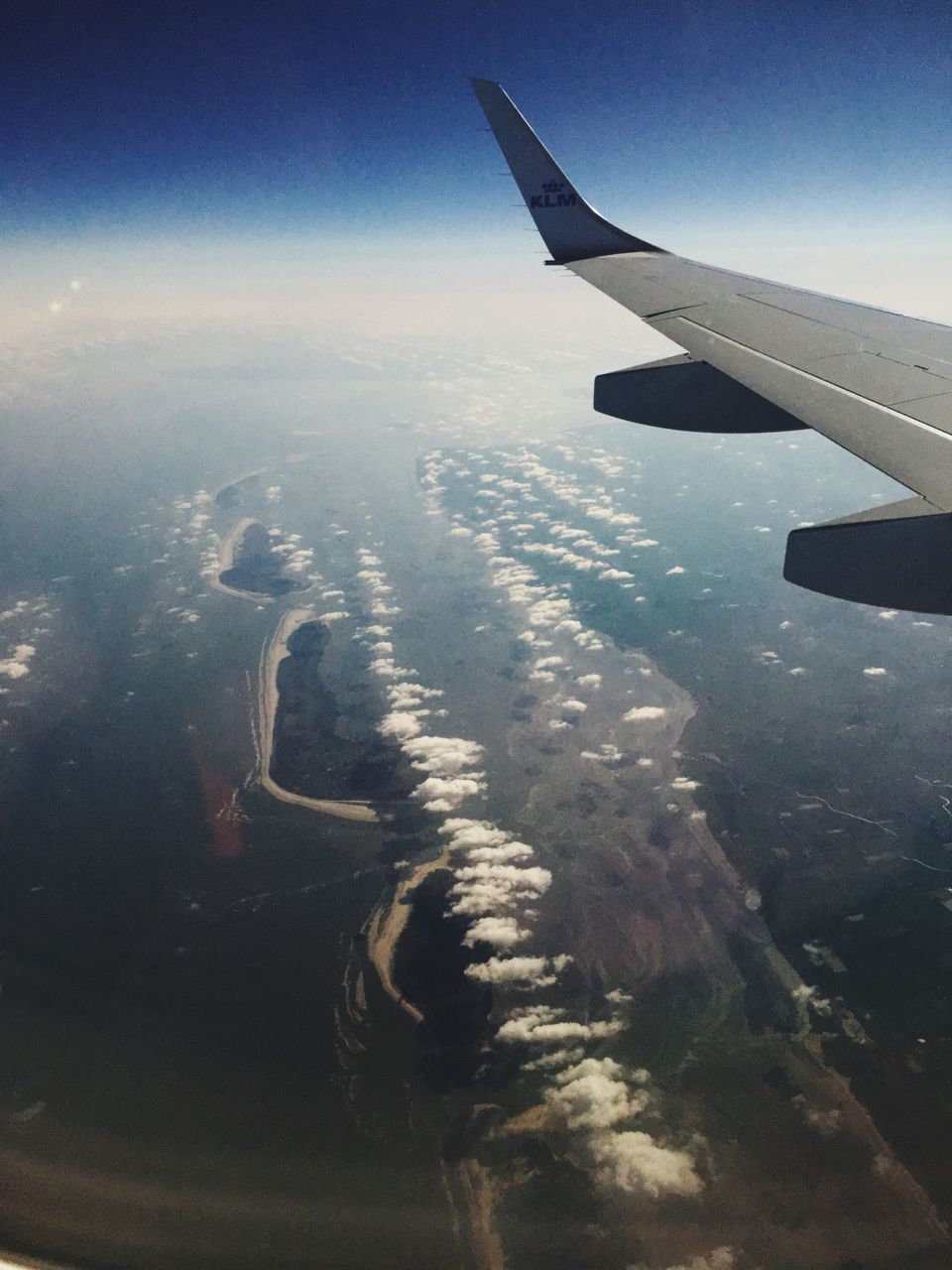 airplane, air vehicle, transportation, mode of transportation, aircraft wing, flying, travel, aerial view, sky, no people, beauty in nature, on the move, nature, journey, motion, mid-air, scenics - nature, landscape, environment, cloud - sky, outdoors, plane