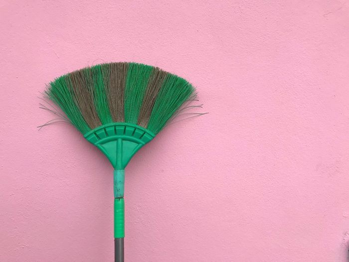 Wall Green Color Pink Color No People Wall - Building Feature Outdoors Cleaning Equipment Broom Single Object