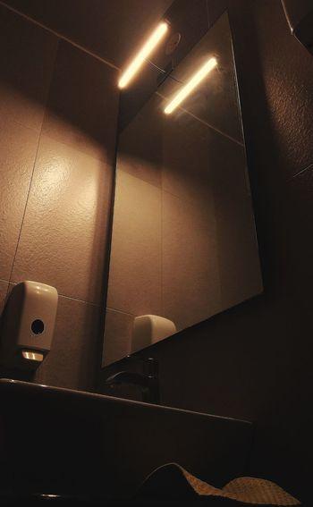 Close-up of illuminated lights on wall at home