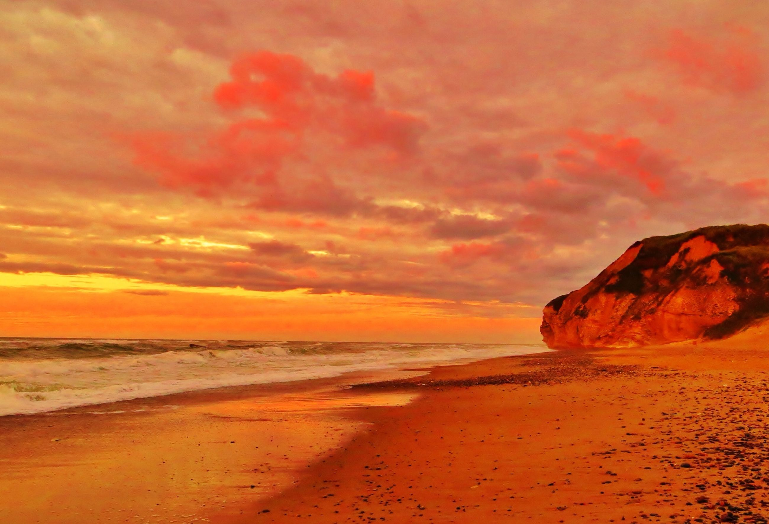 sea, beach, sunset, water, scenics, shore, tranquil scene, beauty in nature, horizon over water, sky, tranquility, orange color, sand, idyllic, nature, rock - object, rock formation, coastline, cloud - sky, wave