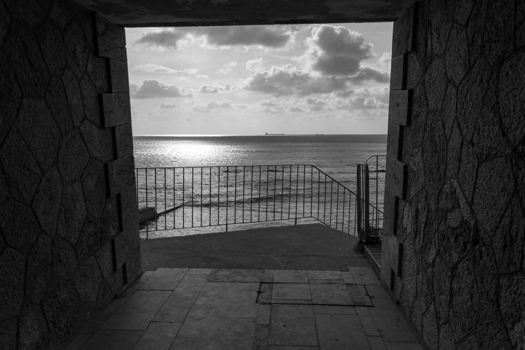 EyeEm Best Shots EyeEm Eye4photography  EyeEm Best Pics Bnw Blackandwhite Black And White Black & White Blackandwhite Photography Monochrome Outdoors Tranquil Scene Cloud - Sky Horizon Over Water Sea Tranquility Scenics - Nature Seascape Seaside Tunnel Sunlight Built Structure Architecture Railing Beauty In Nature