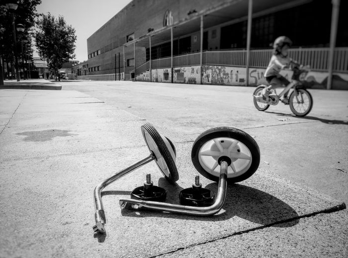 Growing fast Stage Growth Growing Parenting Parenthood Family Blackandwhite Black And White Black & White Childhood Bicycle City Architecture Building Exterior Built Structure Cycling Moments Of Happiness The Art Of Street Photography