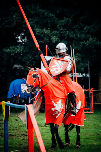 Knight performing jousting while riding on horse