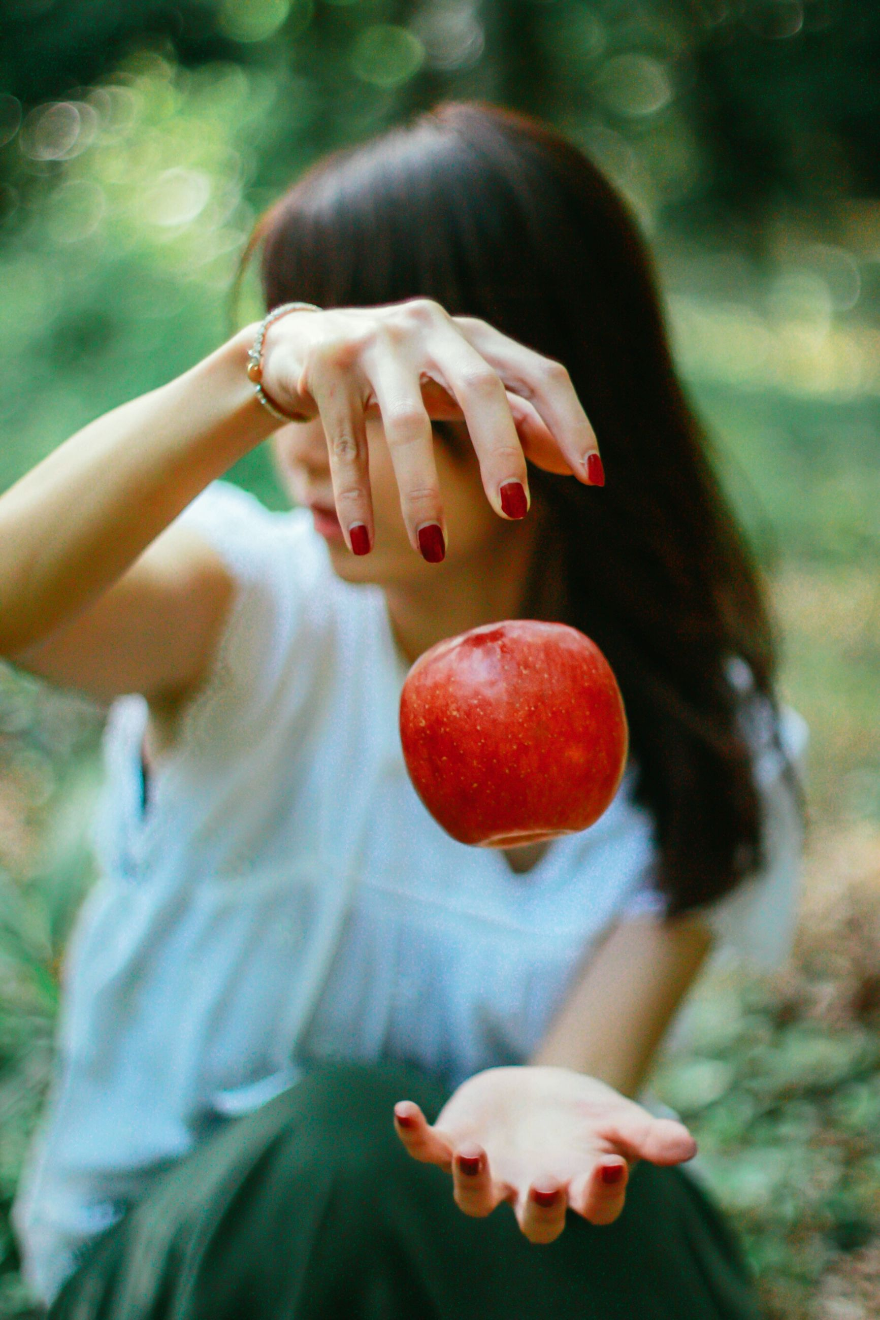 one person, real people, fruit, human hand, red, women, focus on foreground, day, outdoors, human body part, food, close-up, freshness, nature, people