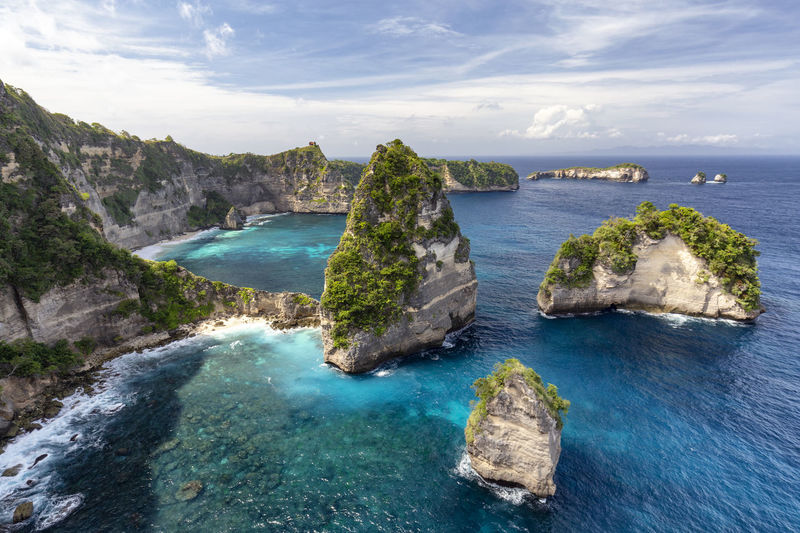 Beautiful view of Raja Lima islands on Nusa Penida in Indonesia. ASIA Atuh Beach Bali Diving Hindu INDONESIA Indonesian Nusa Batupadasan Shrine Tourist Travel Ampoak Atuh Balinese Beach Destination Klungkung Landscape Lebah Nusa Batumategan Nusa Penida Pejukutan Raja Lima Tourism Tropical
