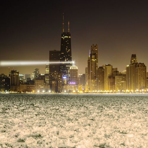 Illuminated Willis Tower And City Against Clear Sky At Night