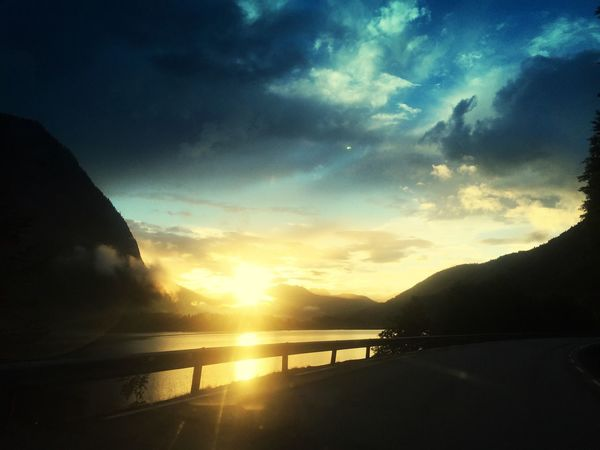 This is what u call sunset. Sunset Sunset_collection From The Car Window Yellow Sky Mountain Norway Amazing Nature Norway Nature Roadtrip Sun Beauty In Nature Cloud