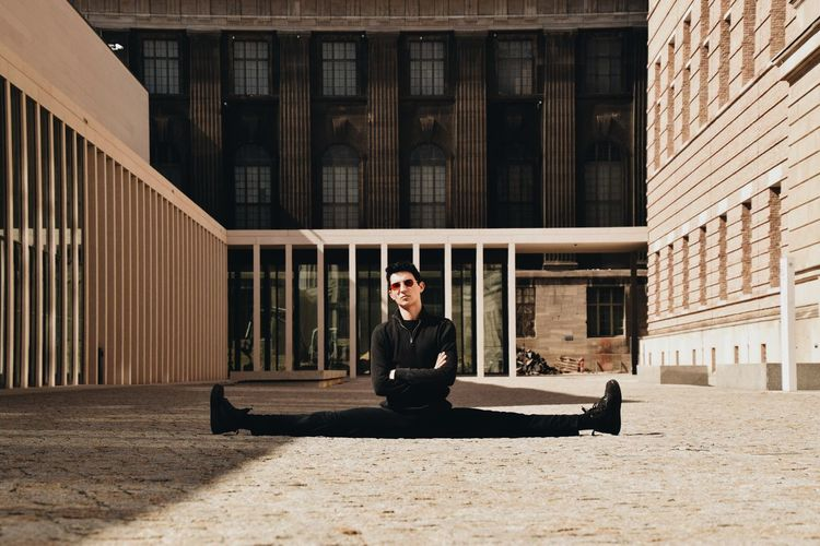 Portrait of man sitting in building
