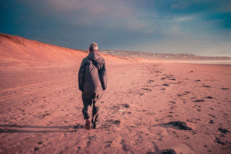 Full length of man walking on desert