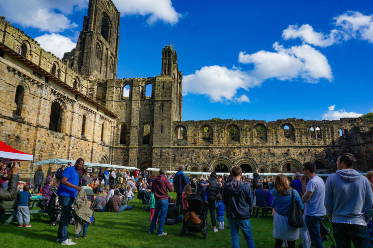 Leeds, England, United Kingdom - September 25, 2016: Kirkstall Abbey in Leeds with crowded people in green field Group Of People Crowd Large Group Of People Architecture Real People Built Structure Building Exterior History The Past Women Sky Men Leisure Activity Adult Tourism Cloud - Sky Travel Destinations Travel Day Lifestyles Outdoors Visit Ancient Civilization Church Architecture Ruins People Travel Tourist Attraction
