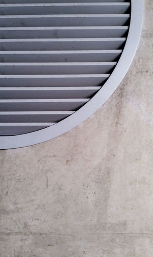 industrial futuristic Circle Grid Girdle Concrete Wall Concrete Ventilation Industrial Futuristic Close-up Full Frame Architectural Detail Geometric Shape Backgrounds Textured  Pattern Repetition Brushed Metal Architectural Design Detail