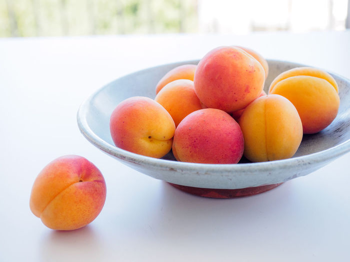Close-up of fruits in bowl on table