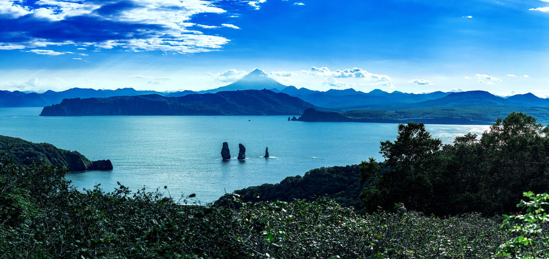 Water Scenics - Nature Mountain Beauty In Nature Sky Tranquil Scene Cloud - Sky Tranquility Plant Blue Sea Nature Mountain Range Idyllic Day Non-urban Scene No People Tree Land Outdoors Bay Mountain Peak