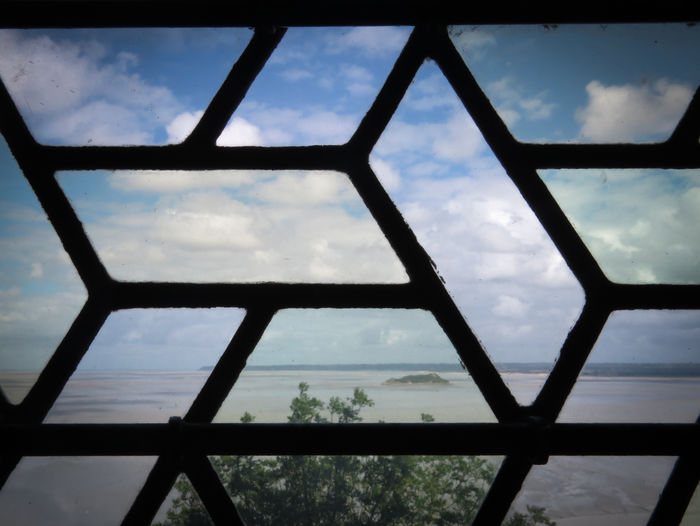 WINDOW WITH A VIEW Le Mont-Saint-Michel Summer Summer2015 Window Landscape Landscape Beach Clouds And Sky Clouds Beach France Tourist Attraction  Tourist Destination View View Wonderful Wonderful Sunny Day Normandie Vacation Vacation Time Beautiful View Beautiful Nature Stained Glass Travel No People
