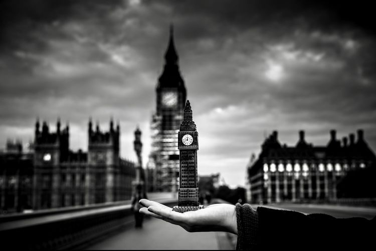 I adore the clouds of London. EyeEmNewHere Minimalism Ornament Clouds And Sky Clouds LONDON❤ London Bigben Architecture Building Exterior Clock Tower Built Structure Tower Travel Destinations Tourism City Human Hand Sky Close-up Day One Person EyeEmNewHere