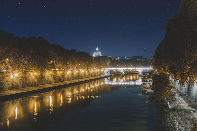 Bridge over river at night
