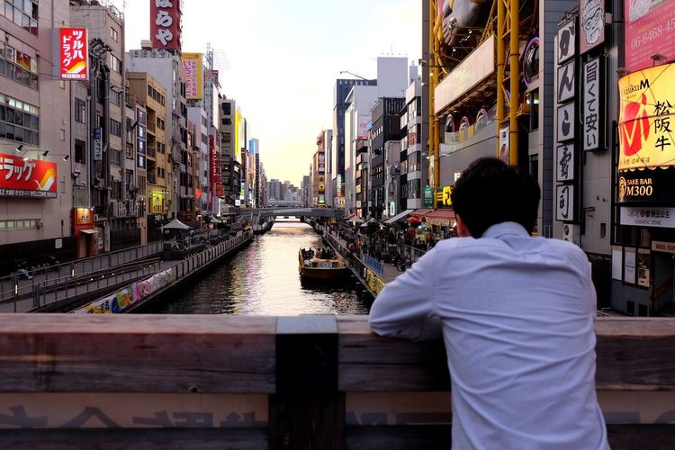 Clearing the mind... Candid Candid Photography Thoughts Thinking About Life Thinking OSAKA Osaka,Japan Japan Travelholic Japantrip Japanculture Japan Photography Culture Of Japan Culture City Lights Citylife Check This Out Checking In Sunset Sunlight City Men Retail  Store City Street Consumerism Sky Billboard Advertisement Commercial Sign