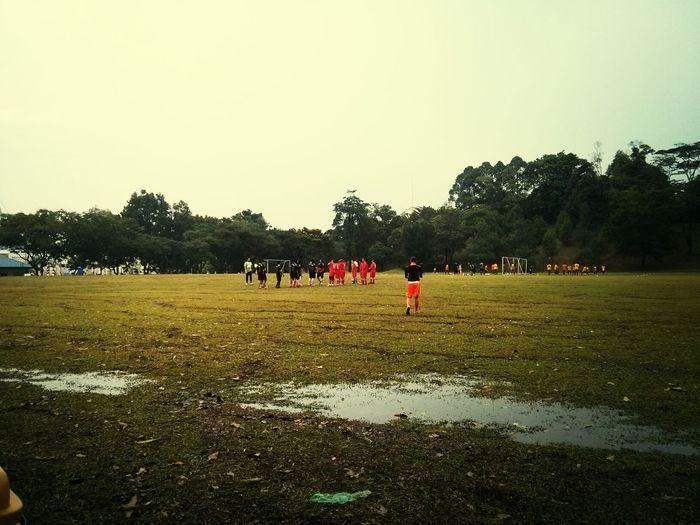 Playing Football Soccer friendly match