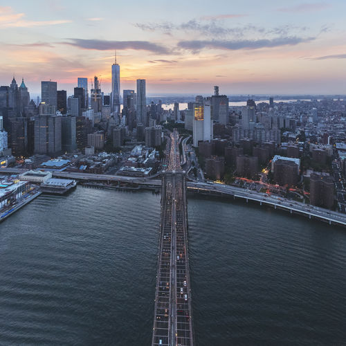 High Angle View Of Brooklyn Bridge Over East River Against Sky During Sunset