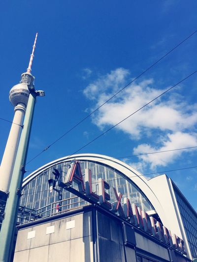 Low Angle View Of Fernsehturm Against Sky At Alexanderplatz In City