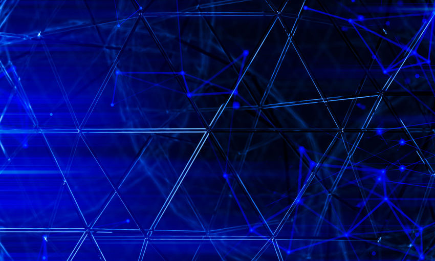 Full frame shot of illuminated cables against blue background
