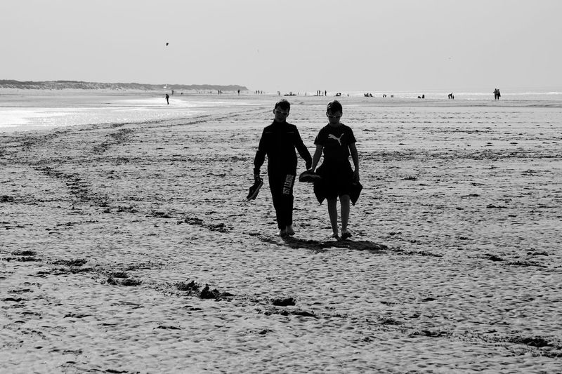Land Beach Sea Water Real People Sky Walking Leisure Activity Togetherness Lifestyles Nature Rear View Scenics - Nature Sand Men Day Group Of People Horizon Over Water Full Length A New Beginning