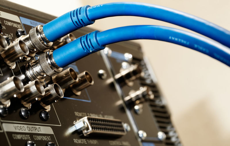 Close-up of blue cable connected to amplifier
