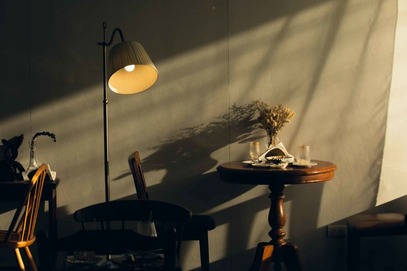 Illuminated electric lamp on table at home