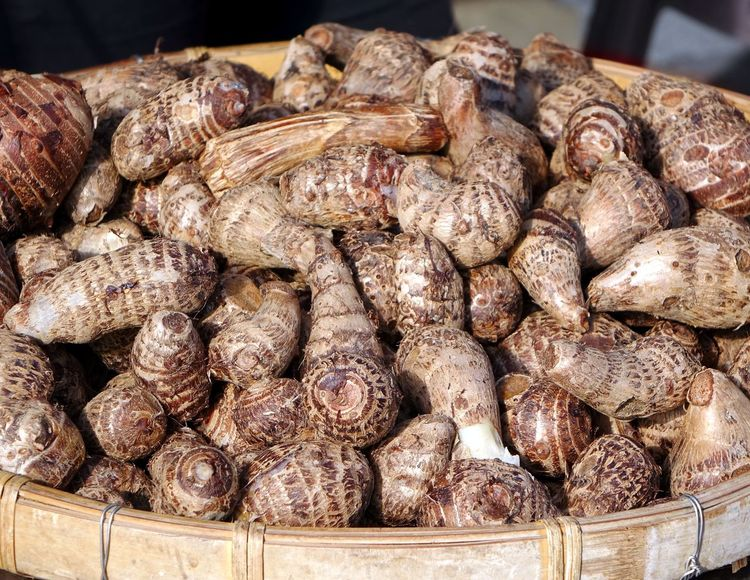 A market vendor sells steamed taro roots Bamboo Material Chinese Food Food Market Stall Steamed  Street Food Taiwan Taro Taro Root