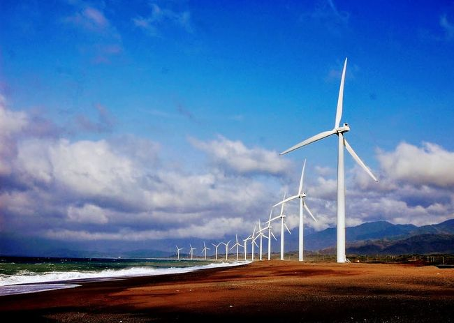 Wind Turbine Wind Power Alternative Energy Fuel And Power Generation Environmental Conservation Renewable Energy Sky Cloud - Sky Electricity  Business Finance And Industry Landscape Sea Blue Beach Technology Outdoors Day Nature Sustainable Resources No People Ilocossur2017 Leisure Activity Eyemphilippines Outdoor Photography Mylife❤ Live For The Story The Great Outdoors - 2017 EyeEm Awards EyeEmNewHere