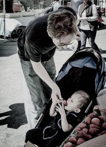 Fatherhood Moments Father & Son Father Feeding  Son Stroller Baby Stroller Caring Baby Man Road Shadows San Francisco Bay Area California Food Produce Strawberries Fruits People And Places