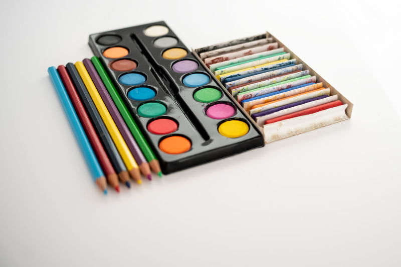 High angle view of multi colored pencils on white table