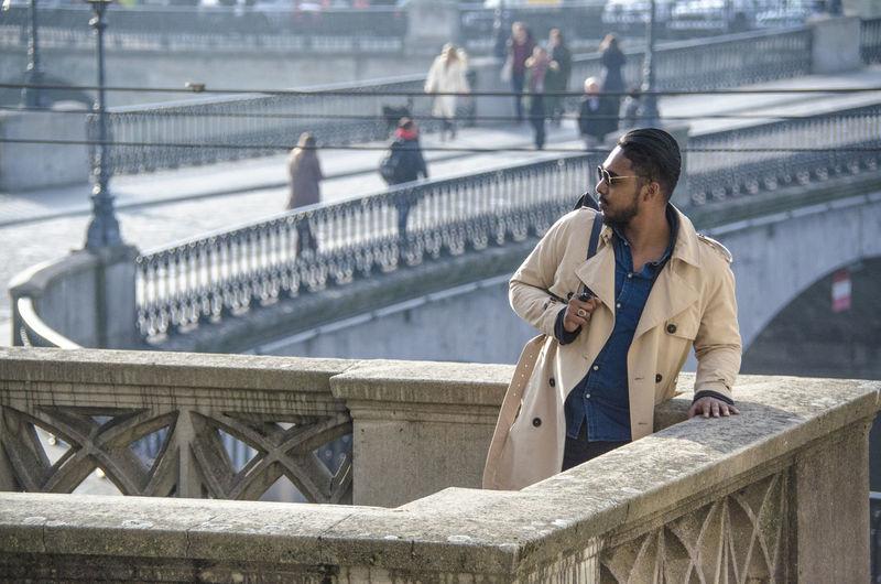 Young man looking away at bridge