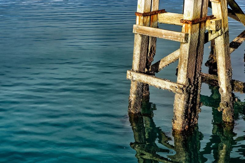 Wooden Ladder Ladder Ladders Wood Rust Rusty Sea Seascape Seaside Water Wood - Material Nature Beach Photography Textured  Wooden Frame Wooden Post Wood Grain Reflection Water Reflections Ripples Rippled