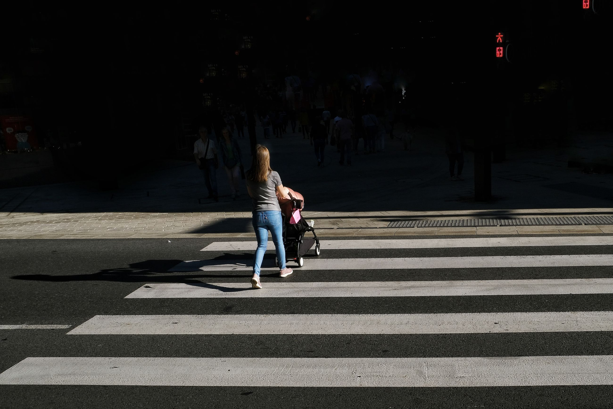 crosswalk, road marking, city, road, zebra crossing, crossing, symbol, street, sign, marking, real people, transportation, full length, women, lifestyles, people, city life, walking, casual clothing, architecture, outdoors