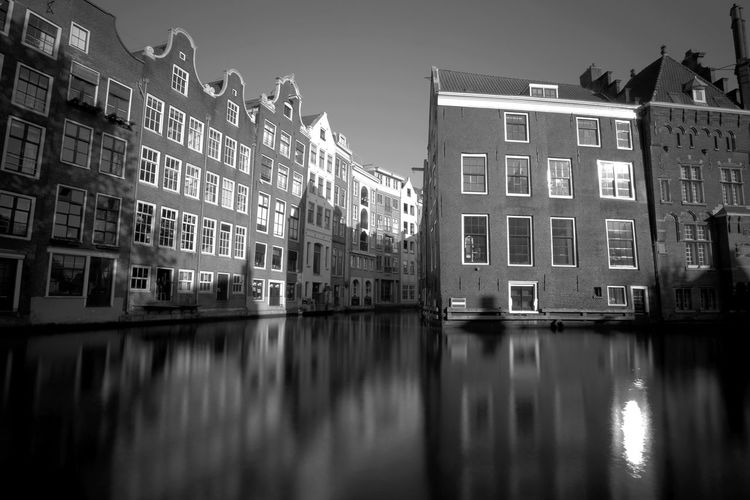 A canal in Amsterdam. Amsterdam Architecture Black And White Blackandwhite Building Exterior Buildings Built Structure Canal Canals City Day Gracht Grachten No People Outdoors Reflection Sky Water Water Reflections Waterfront Fujifilm FUJIFILM X-T2 Fujifilm_xseries