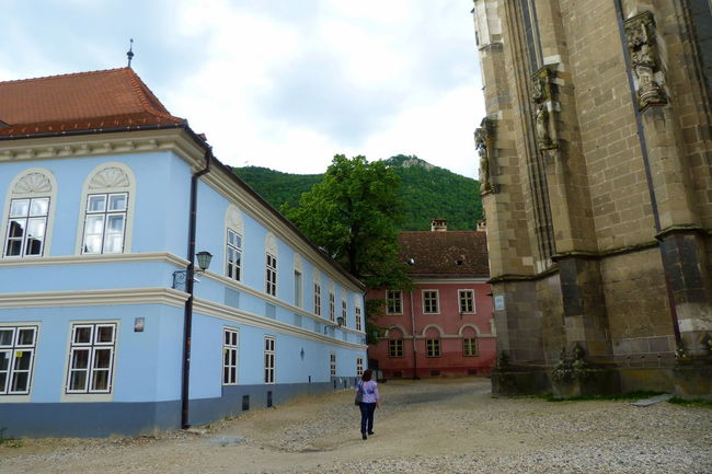 Architecture Black Church Brasov Building Building Exterior Built Structure Casual Clothing City Life Cloud Cloud - Sky Day Full Length Leisure Activity Lifestyles Outdoors Residential Building Residential Structure Romania Sky Travel Destinations Showcase June