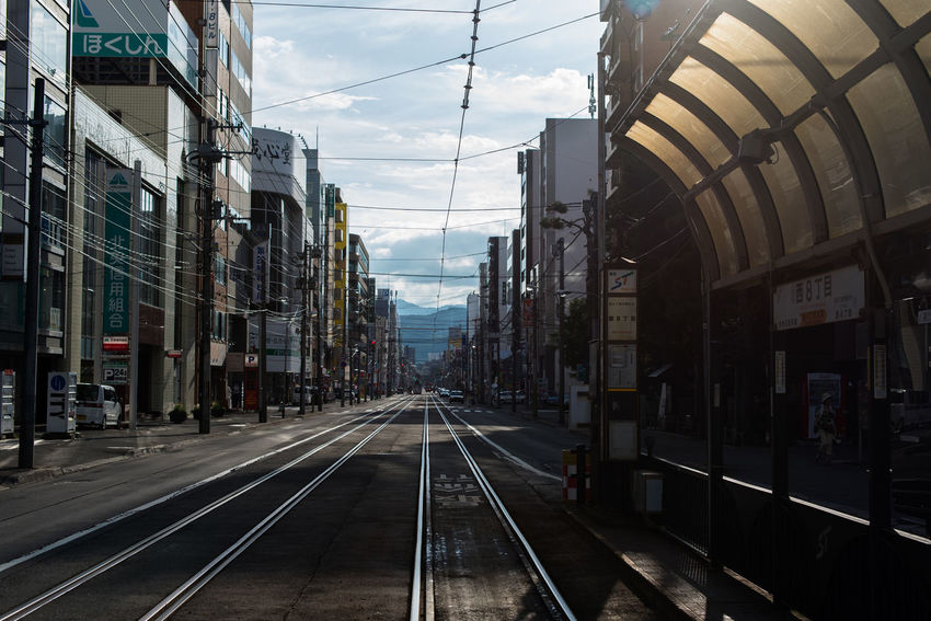 Architecture Building Built Structure City City Life Cloud - Sky Diminishing Perspective Empty Empty Streets Hokkaido,Japan Japan No People Outdoors Public Transportation Railroad Track Railtrack Sapporo Sapporo,Hokkaido,Japan Sky Street Photography The Way Forward Tram Tram Stop Tramway Vanishing Point
